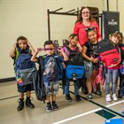500 Local Kids Receive School Supplies